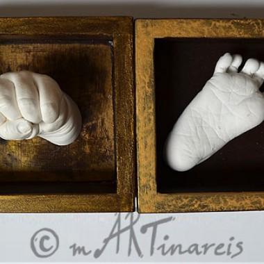 Babyhand und Füßchen